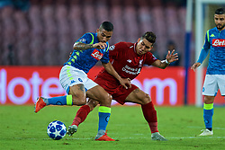 NAPLES, ITALY - Wednesday, October 3, 2018: Liverpool's Roberto Firmino (R) challenges Napoli's Allan Marques Loureiro (L) during the UEFA Champions League Group C match between S.S.C. Napoli and Liverpool FC at Stadio San Paolo. (Pic by David Rawcliffe/Propaganda)