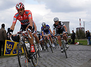 France, Valenciennes, Sunday 11th April 2010: Fabian Cancellara (Saxo Bank) rides in front of Cervelo's Thor Hushovd on section 16, Hornaing à Wandignies-Hamage (3,7km) pave during the 108th edition of the Paris Roubaix cycle race. Copyright 2010 Peter Horrell.
