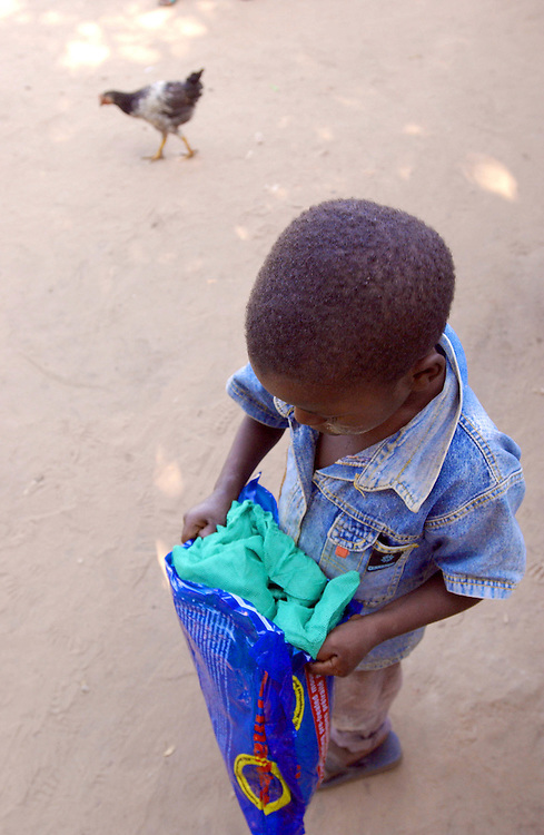 A child holds a mosquito net.