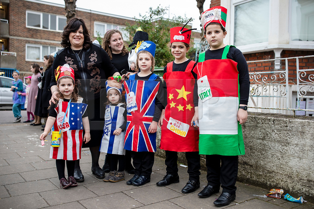 © Licensed to London News Pictures. 21/03/2019. London, UK. The Orthodox Jewish community celebrate the festival of Purim on the streets of Stamford Hill in north London on 21 March 2019. Purim celebrates the miraculous salvation of the Jews from a genocidal plot in ancient Persia, documented in the Book of Esther. Traditionally the jewish community wear fancy dress and exchange gifts of food and drink. Photo credit: Rob Pinney/LNP