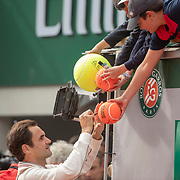 PARIS, FRANCE May 29.   Roger Federer of Switzerland signs autographs after his win against Oscar Otte of Germany on Court Philippe-Chatrier in the Men's Singles second round match at the 2019 French Open Tennis Tournament at Roland Garros on May 29th 2019 in Paris, France. (Photo by Tim Clayton/Corbis via Getty Images)