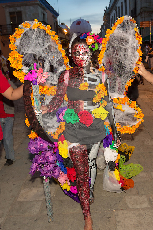 A woman dressed in an elaborate costume during the Day of the Dead Festival known in spanish as Día de Muertos October 25, 2014 in Oaxaca, Mexico.