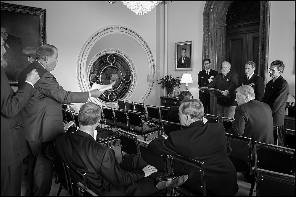Sen. Frank Murkrowski expresses his concern over the legal ramifications of returning to his office to retrive some things in the Hart Building before it officially reopens to Greg Martin, Doctor of Infecteous Diseses at Bethesda Naval Hospital, Incident Commander David Stutz,  Attending Physican for the Capitol Dr. John Eisold, and Senate Majority Leader Tom Daschle after a meeting in Senator Daschle's office concerning the reopening of the Hart Building.  10/24/01..©PF BENTLEY/PFPIX.com