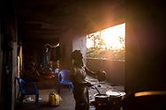 BEIRA, MOZAMBIQUE - JUNE 25, 2016: <br /> Ana Alberta, 25 years old, cooking for her family.