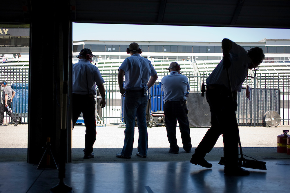 A pit crew awaits for the return of their car during warm-ups for ARCA/REMAX series cars at the Rockingham Speedway.