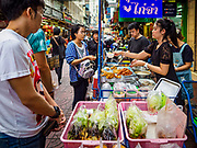 "18 MAY 2017 - BANGKOK, THAILAND: A fried meat street stall on a side street in Bangkok's Chinatown. City officials in Bangkok have taken steps to rein in street food vendors. The steps were originally reported as a ""ban"" on street food, but after an uproar in local and international news outlets, city officials said street food vendors wouldn't be banned but would be regulated, undergo health inspections and be restricted to certain hours on major streets. On Yaowarat Road, in the heart of Bangkok's touristy Chinatown, the city has closed some traffic lanes to facilitate the vendors. But in other parts of the city, the vendors have been moved off of major streets and sidewalks.      PHOTO BY JACK KURTZ"