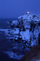 A lighthouse atop snow-covered cliffs on Notsuke Bay.