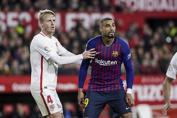 January 23, 2019 - Seville, Spain - KEVIN-PRICE BOATENG of Barcelona (R) fights for the ball with. SIMON KJAER of Sevilla (L)  during the King's Cup quarter-final first leg soccer match between Sevilla FC and FC Barcelona at Sanchez Pizjuan Stadium (Credit Image: © Daniel Gonzalez Acuna/ZUMA Wire)