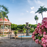 A fountain and pergola in the center of Parque Central. Parque Central is the main square and the historic heart of Granada, Nicaragua.