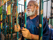 "06 JULY 2015 - BANGKOK, THAILAND: A human rights activist in a mock jail cell to call attention to the plight of students arrested for charges related to political assembly. More than 100 people gathered at Thammasat University in Bangkok Monday to show support for 14 students arrested two weeks ago. The students were arrested for violating orders against political assembly. They face criminal trial in military courts. The students' supporters are putting up ""Post It"" notes around Bangkok and college campuses up country calling for the students' release.      PHOTO BY JACK KURTZ"