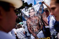 Protestors against the President of Guatemala carry a poster with a photo of President Alvaro Colom on the body of a MS 13 gang member as citizens take to the streets as a day of protest in connection with Guatemala's President Alvaro Colom Guatemala City May 17, 2009. . Thousands of protesters took to the streets of the capital  Sunday in two separated rival marches, one in support of the President and one denouncing President Alvaro Colom who was accused this week of murder, money laundering and having ties with narco-traffickers.(Darren Hauck)