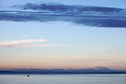 Dusk over Burrard Inlet and Vancouver International Airport, seen from aboard Rhapsody of the Seas cruise ship of Royal Caribbean, after leaving Vancouver.