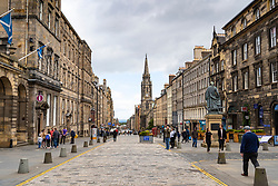 Edinburgh, Scotland, UK. 28 July, 2020. Business and tourism slowly returning to the shops and streets of Edinburgh city centre.View of the Royal Mile in the Old Town which is still much quieter than normal at this time of year.  Iain Masterton/Alamy Live News