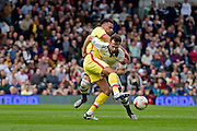 Fulham Defender Richard Stearman (5) battles for the ball during the Sky Bet Championship match between Fulham and Milton Keynes Dons at Craven Cottage, London, England on 2 April 2016. Photo by Jon Bromley.