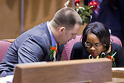 09 JANUARY 2012 - PHOENIX, AZ:  Democratic State Sen David Schapira, Tempe, talks to Sen Leah Landrum Taylor at the state legislature Monday. Gov Brewer delivered her State of the State inside while outside representatives of interest groups picketed and protested.    The Arizona legislature started its 2012 session and Gov. Jan Brewer delivered her State of the State Monday, Jan 9.                   PHOTO BY JACK KURTZ