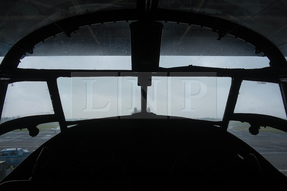 © Licensed to London News Pictures. <br /> 28/08/2014. <br /> <br /> Durham Tees Valley Airport, United Kingdom<br /> <br /> The view out of the cockpit from one of only two remaining flying Avro Lancaster bombers as it visits Durham Tees Valley airport today. <br /> <br /> The aircraft, 'Mynarski' is named after Pilot Officer Andrew Mynarski who flew with the Canadian Royal Air Force from the airport which was then called RAF Middleton St George.<br /> <br /> Pilot Officer Mynarski was posthumously awarded a VC after giving his life while trying to save a colleague when their Lancaster was shot down in June 1944.<br /> <br /> The famous World War Two aircraft is owned by the Canadian Warplane Heritage Museum and is beginning a 2-week tour of the UK.<br /> <br /> Photo credit : Ian Forsyth/LNP