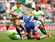 LONDON, ENGLAND - Saturday 10 May 2014, Kwagga Smith of South Africa runs into Jean Baptiste Mazoue of France during the match between South Africa and France at the Marriott London Sevens rugby tournament being held at Twickenham Rugby Stadium in London as part of the HSBC Sevens World Series.<br /> Photo by Roger Sedres/ImageSA