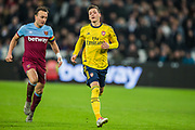 Mark Noble (Capt) (West Ham) & Mesut Ozil (Arsenal) running towards the ball during the Premier League match between West Ham United and Arsenal at the London Stadium, London, England on 9 December 2019.