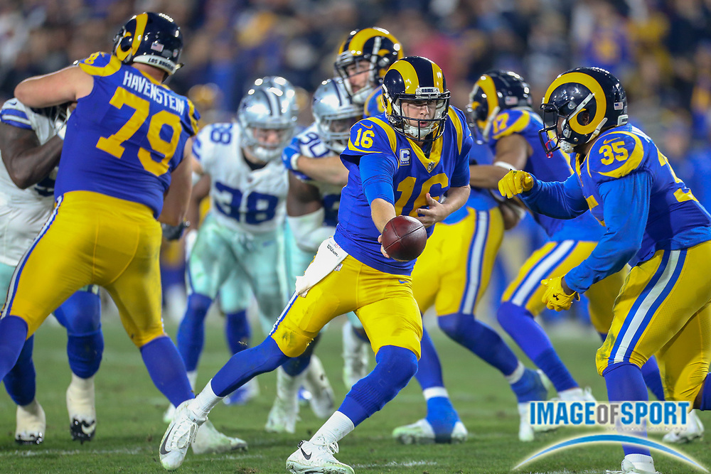 Jan 12, 2019; Los Angeles, CA, USA; Los Angeles Rams quarterback Jared Goff (16) attempts to handoff the ball to running back C.J. Anderson (35) against the Dallas Cowboys during an NFL divisional playoff game at the Los Angeles Coliseum. The Rams beat the Cowboys 30-22. (Kim Hukari/Image of Sport)