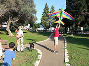 Children fly a kite in a park