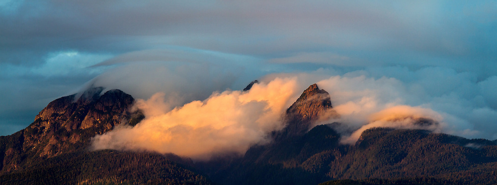 Clouds clearing from Mount Blandshard (The Golden Ears) during sunset - photographed from Tavistock Point at Brae Island Regional Park in Langley, British Columbia, Canada
