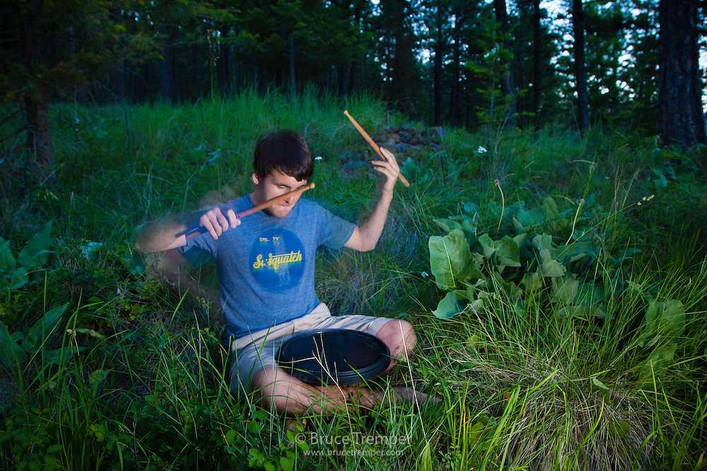 Brian Tremper practicing his drumming, Flathead Lake, Montana