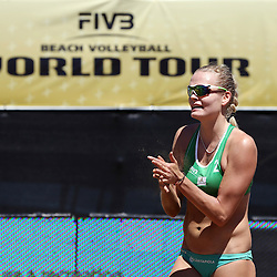 BLOEMFONTEIN, SOUTH AFRICA - DECEMBER 12: Taru Lahti of Finland happy to take a point in the match between Lane Carico and Kimberly Dicello of the USA vs Taru Lahti and Riikka Lehtonen of Finland during Day 4 of the FIVB Mangaung Open on December 12, 2014 in Bloemfontein, South Africa.  (Photo by Steve Haag/Getty Images for FIVB)