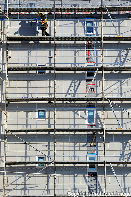 Ian Stewart/Yukon News<br /> A worker makes his way across the scaffolding which surrounds the six-storey Mah's Point condominium development in downtown Whitehorse on Thursday.