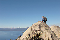 Hiker on boulder at coast