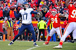 Jan 19, 2020; Kansas City, Missouri, USA; Tennessee Titans quarterback Ryan Tannehill (17) throws a pass against Kansas City Chiefs outside linebacker Terrell Suggs (94) during the second half in the AFC Championship Game at Arrowhead Stadium. Mandatory Credit: Denny Medley-USA TODAY Sports