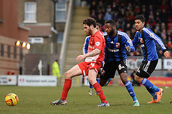 Orient's Romain Vincelot shields the ball - Photo mandatory by-line: Mitchell Gunn/JMP - Tel: Mobile: 07966 386802 22/02/2014 - SPORT - FOOTBALL - Brisbane Road - Leyton - Leyton Orient V Swindon Town - League One