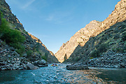 Beautiful water surrounds boaters during morning in The Impassible Canyon on the Middle Fork of the Salmon River during six day rafting vacation, Idaho.