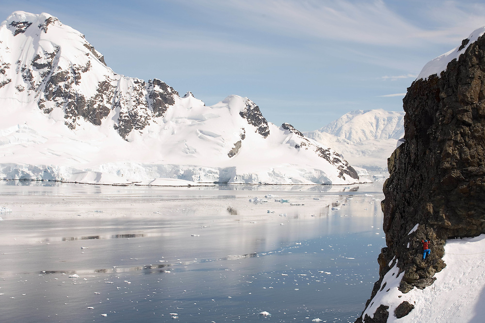 Antarctica. Jonathan Thompson climbs a rock face in paradise bay.