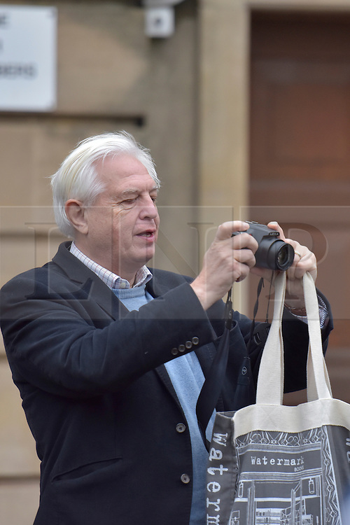 © Licensed to London News Pictures. 06/11/15 Oriel Square Oxford. UK. Jon Simpson takes a photo. Protest for the removal of the statue of Cecil Rhodes which is in the front of Oriel College Oxford.. Photo credit : MARK HEMSWORTH/LNP