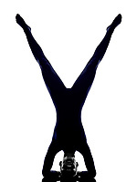 woman exercising vrschikasana scorpion pose yoga silhouette shadow white background