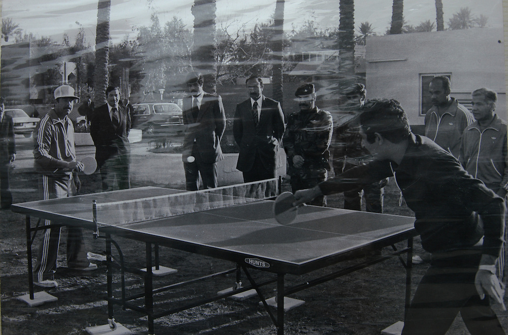 A family photo of Saddam Hussein playing ping-pong with Saddam Kamel, his son-in-law. Kamel, his brother Hussein and 15 family members were killed by Saddam when the two brothers returned to Iraq after fleeing to Jordan..Baghdad, Iraq. 30 May 2003..Photo © J.B. Russell