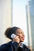 Smiling African American young woman using mobile phone