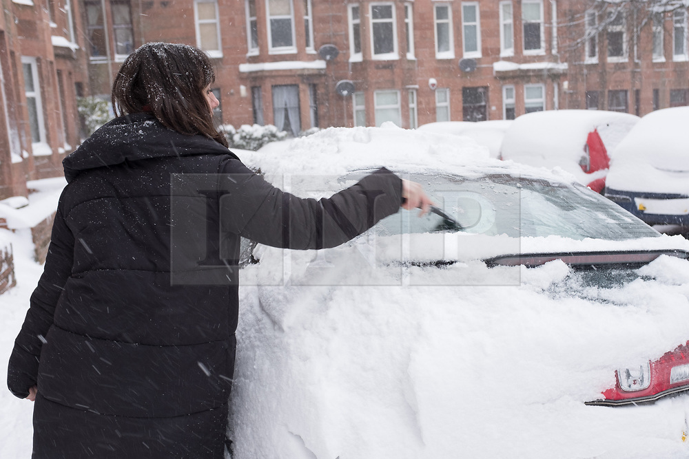 "© Licensed to London News Pictures. 28/02/2018. <br /> <br /> A woman deices her car in Springhill Gardens, Shawlands, Glasgow, Scotland as the city hit with snow storm ""Beast from the East"" on 28th February 2018.<br /> <br /> Photo credit should read Max Bryan/LNP"