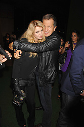 COURTNEY LOVE and MARIO TESTINO at a party to celebryate the launch of the Spring Summer 2008 adidas collection by Stella McCartney held at the Westway Sports Centre, off Latimer Road, London W10 on 20th September 2007.<br />