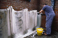 Council Cleansing Dept worker cleaning a public toilet ......