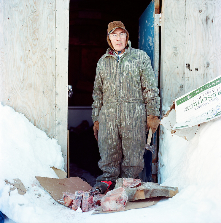 Johnnie Weyiouanna  .Johnnie Weyiouanna, outside of his shed in Shishmaref, Alaska in March 2010 ..Johnnie, one of the original contributors to the 1951 Eskimo Cookbook, still practices a subsistence lifestyle. He, his wife, and their children hunt caribou, polar bear, seal, and other animals, then freeze and cook them throughout the year.