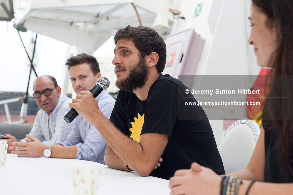 Journalists attend a press conference, chaired by Ghalia Fayad (right) and Julien Jreissati (centre), aboard the Greenpeace ship Rainbow Warrior, during The Sun Unites Us tour promoting solar power in the Arab world, in Casablanca, Morocco, on 4 November 2016.