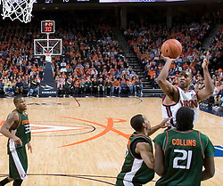 Virginia Cavaliers guard J.R. Reynolds (2) shoots over Miami Hurricanes guard Anthony Harris (12) and Miami Hurricanes forward Dwayne Collins (21). Reynolds had 18 points as The University of Virginia Cavaliers defeated the Miami Hurricanes Men's Basketball Team 81-70 at the John Paul Jones Arena in Charlottesville, VA on February 3, 2007.