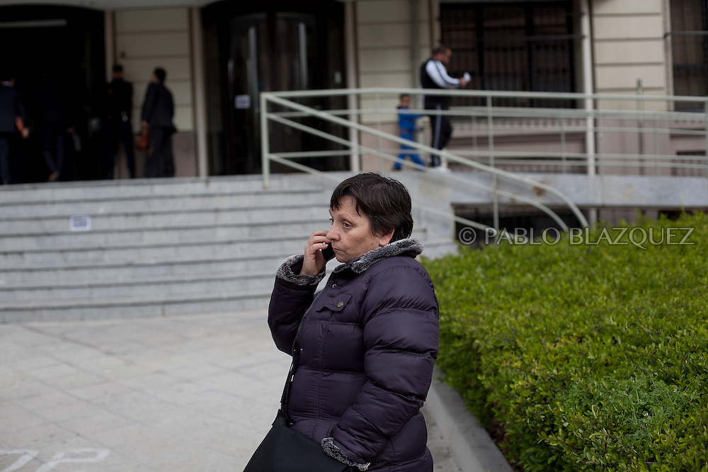 Amalia Torres 51, speaks on the phone one day before her eviction takes place outside the Madrid's Council Housing Office where she spent the night claiming to stop her eviction on April 3, 2013 in Madrid, Spain. The Mortgage Holders Platform (PAH) and other anti evictions organizations are organizing 'escraches' since several weeks ago outside Popular Party deputies houses and offices to demand the vote for a Popular Legistative Initiative (ILP) to stop evictions, regulate dation in payment and social rent.