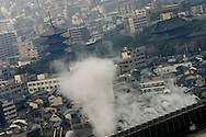 Steam rises from air conditioning units in front of Toji Temple pagoda, seen from the observation deck of the Kyoto Tower, in Kyoto, Japan, on Tuesday, Jan. 16, 2007.
