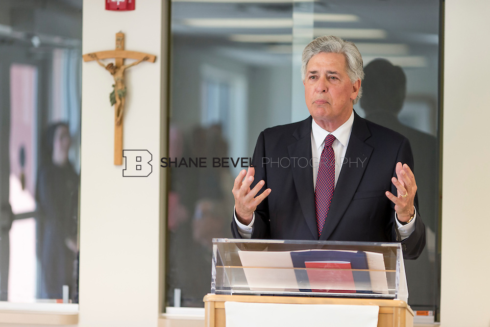 9/29/16 4:06:42 PM --  Bishop David Konderla blesses the newly remodeled Xavier Clinic in east Tulsa. <br /> <br /> Photo by Shane Bevel