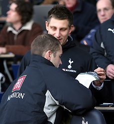 LONDON, ENGLAND - Saturday, February 2, 2008: Tottenham Hotspur's goalkeeper Paul Robinson looks for his name on the teamsheet with press officer Simon Felstein against Manchester United during the Premiership match at White Hart Lane. (Photo by Chris Ratcliffe/Propaganda)