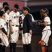 24 February 2018: The San Diego State Aztec baseball team competes in day two of the Tony Gwynn legacy tournament against #4 Arkansas. San Diego State Aztecs pitcher Daniel Ritcheson (30) is taken out of the game by pitching coach Sam Peraza (26) in the top of the ninth inning with a runner on first and the game tied 2-2. The Aztecs dropped a close game to the Razorbacks 4-2. <br /> More game action at sdsuaztecphotos.com