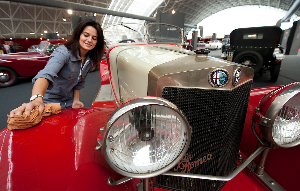 MILAN, ITALY - JUNE 23: Final touches and polishing are made on a 1925 RL Super Sport at an Alfa Romeo exhibition on June 23, 2010 in Milan, Italy.  Italian car manufacturer Alfa Romeo celebrates its 100th anniversary as the original company A.L.F.A was founded in Milan on June 24, 1910...***Agreed Fee's Apply To All Image Use***.Marco Secchi /Xianpix. tel +44 (0) 207 1939846. e-mail ms@msecchi.com .www.marcosecchi.com