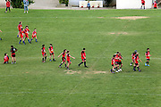 children preparing on the field for soccer game